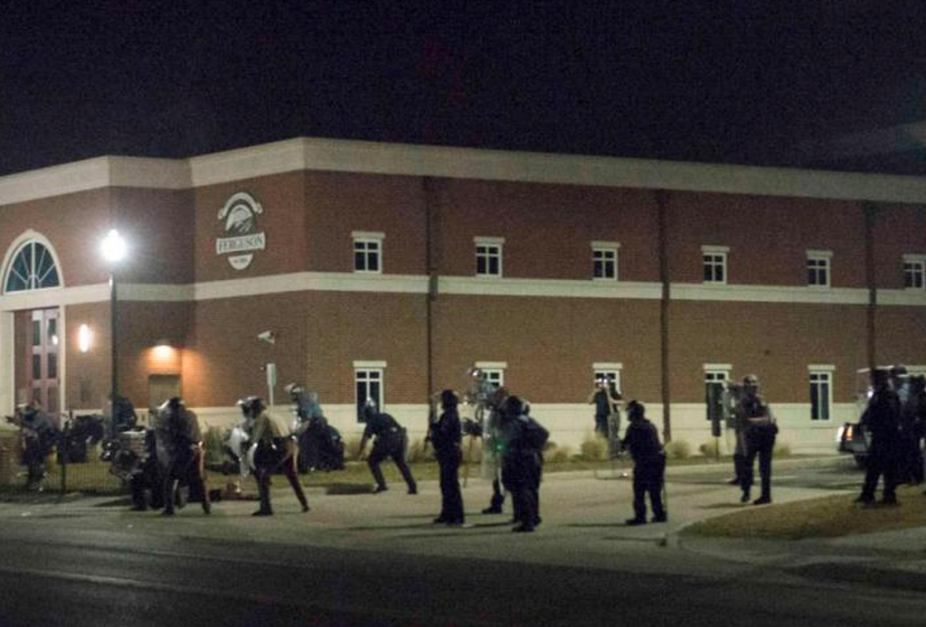 Ferguson cops drew their weapons seconds after a sniper shot two of their colleagues