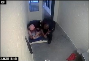 Screen grab from a video of Denver sheriff's Deputy Edward Keller choking inmate Jamal Hunter, recorded in the summer of 2011. (Denver Post file)