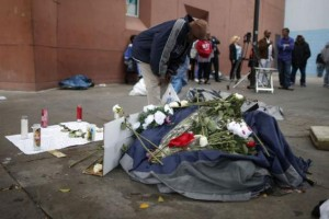 A man views a memorial for a man killed by police on skid row in Los Angeles, California, March 2, 2015. Reuters/Lucy Nicholson