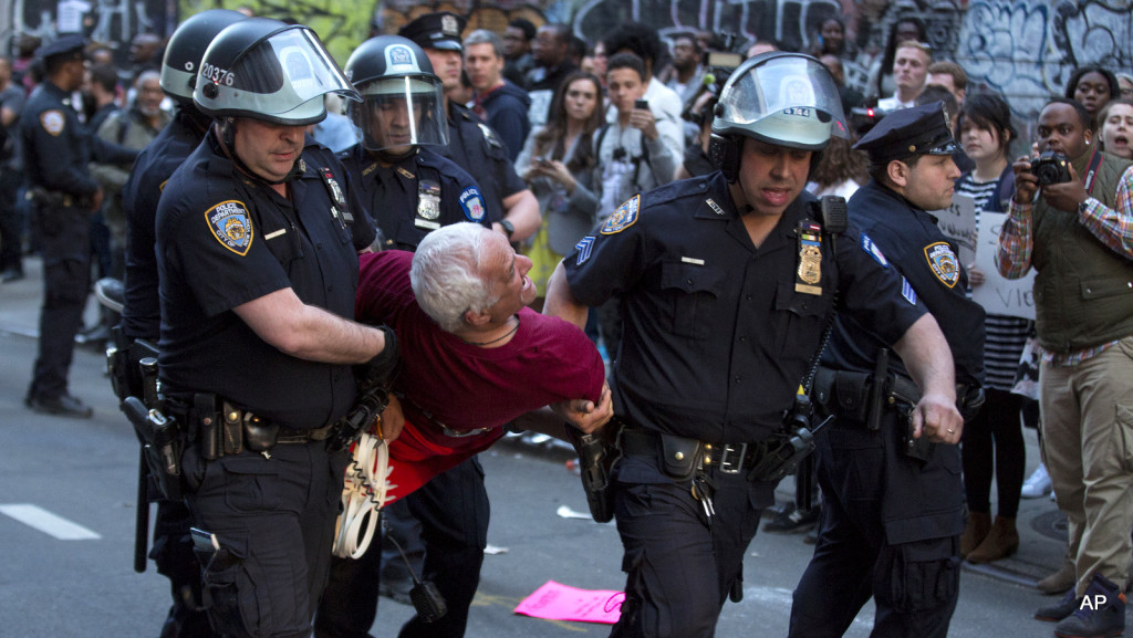 A man is carried by police officers as arrests are made near Union Square, Wednesday, April 29, 2015, in New York. People gathered to protest the death of Freddie Gray, a Baltimore man who was critically injured in police custody. (AP Photo/Craig Ruttle)