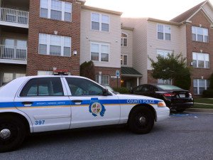 A Baltimore County Police cruiser parked outside the condominium