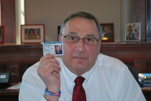 Gov. Paul LePage displays his concealed weapons permit in this photograph released by his office on Thursday, February 14, 2013.