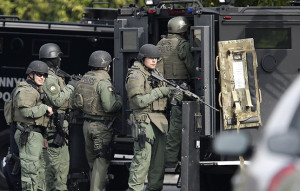 SWAT team members surround a home on Eisenhower Dr. that a possible robbery suspect ran into following a chase in Santa Clara, Calif. on Monday, Nov. 11, 2013.