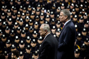 NEW YORK, NY - DECEMBER 29:  New York Police Department (NYPD) Commissioner Bill Bratton (L) and New York City Mayor Bill de Blasio attend a NYPD graduation ceremony at Madison Square Garden on December 29, 2014 in New York City. The Mayor's relationship with the city's police force has been strained recently after the deaths of two police officers.  (Photo by Andrew Burton/Getty Images)