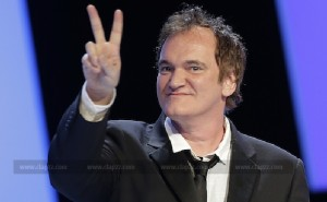 U.S. director Quentin Tarantino flashes a victory sign as he arrives on the stage during the 39th Cesar Awards ceremony in Paris February 28, 2014. REUTERS/Jacky Naegelen (FRANCE - Tags: ENTERTAINMENT) - RTR3FUHN